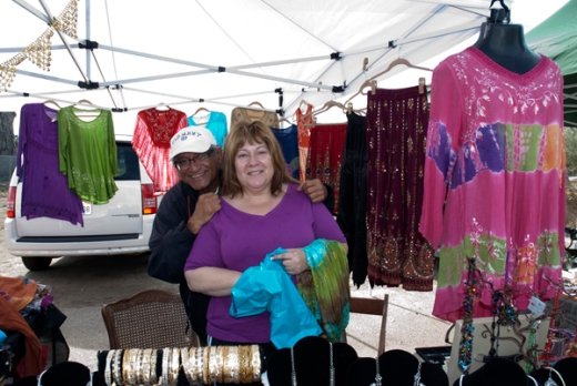 Couple selling clothing at Farmers Market